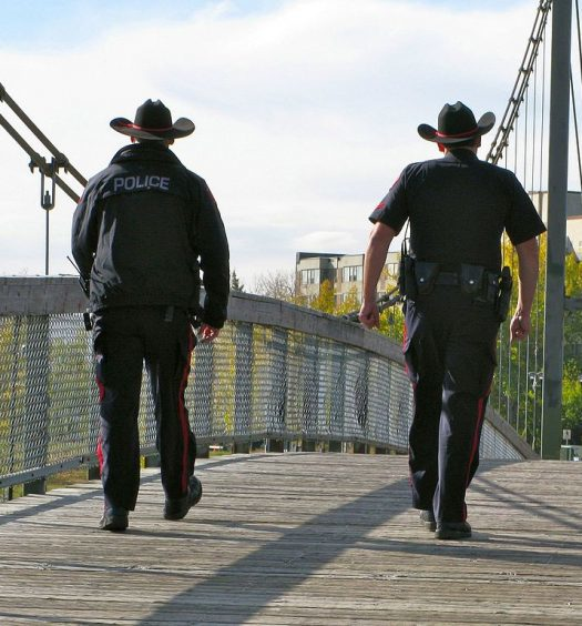 Calgary police officers on patrol. Photo courtesy Heather/Creative Commons Attribution 2.0 Generic.