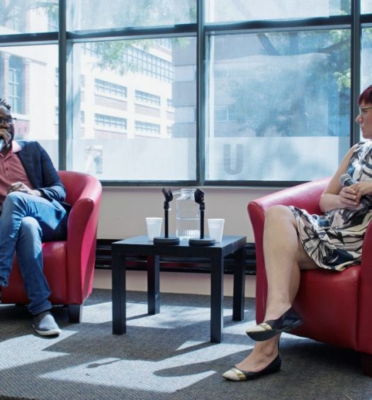 """Ugandan director Kamoga Hassan discusses his film, """"Outed: The Painful Reality,"""" with journalist and queer media instructor Andrea Houston. Photo courtesy Jessica Ross."""