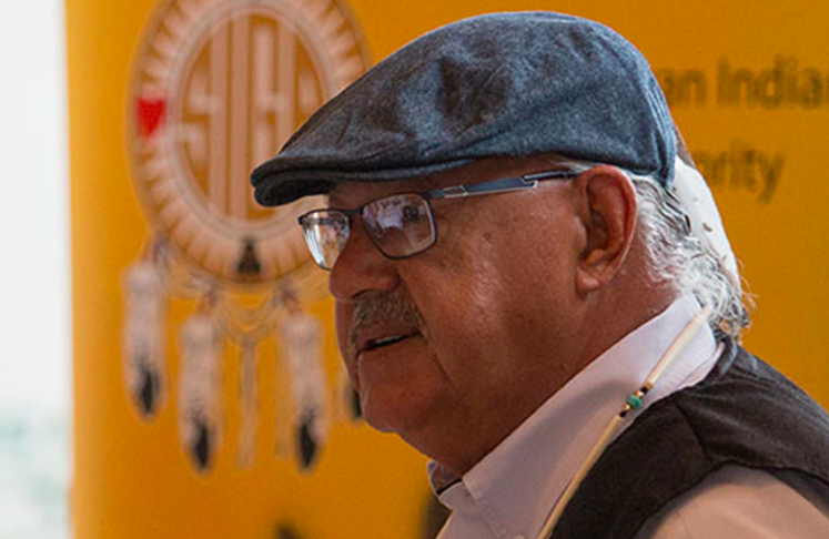 Eugene Arcand, residential school survivor, delivering his speech at the Reconciliation and the Media conference in Saskatoon in October. Photo by Caitlin Taylor.