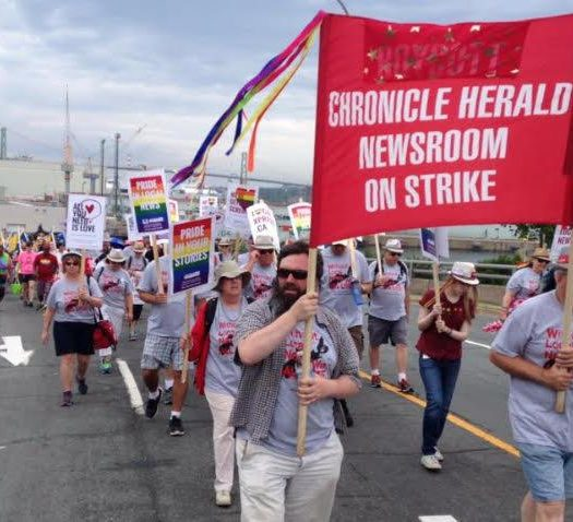Long road: Chronicle Herald strikers at a Halifax pride parade back in June. Photo courtesy Tim Krochak.