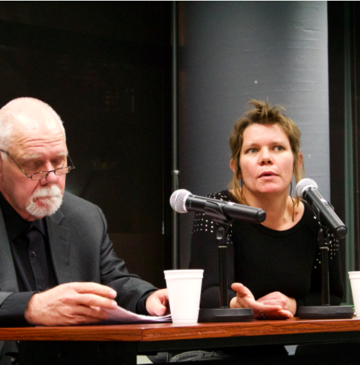 Robert Washburn, professor of journalism at Loyalist College, and Gretchen King, PhD candidate and community media advocate, discuss their research at the Journalism in Crisis book launch panel at the Ryerson School of Journalism Feb. 9. Photo courtesy of Steph Wechsler.