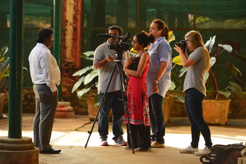 The Bangalore food team interviews a state government official about food security in the city's renowned Lalbagh Botanical Garden. Photo by Prabhu Mallikarjunan/Courtesy of the Tyee.